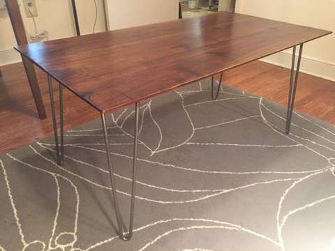 bare metal hairpin legs on walnut coffee table
