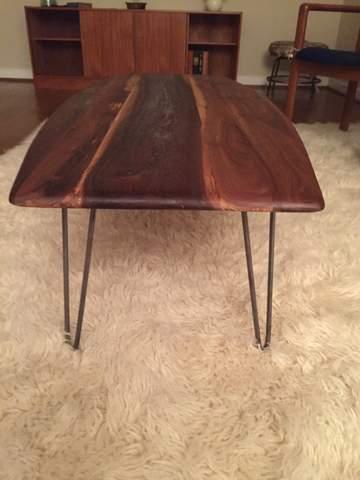 mid century inspired walnut surfboard coffee table