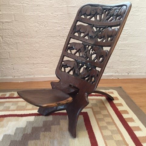 primitive-carved-tension-chair-African-wildlife-motif