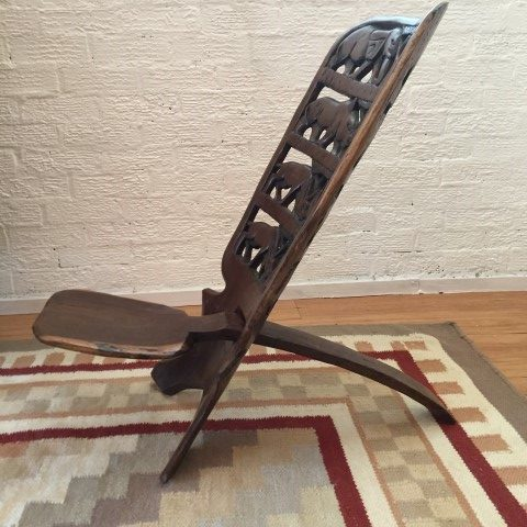 primitive-carved-tension-chair-African-wildlife-motif