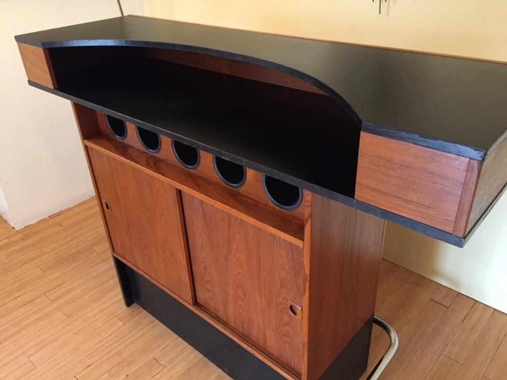 https://epochfurnishings.com/2017/12/08/vintage-danish-teak-wine-bar-black-top-chrome-footrest