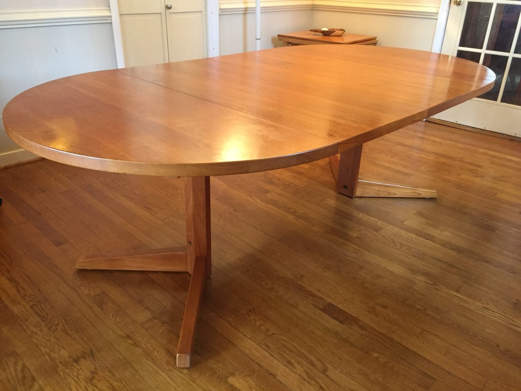 Danish modern solid teak circular dining table with leaves